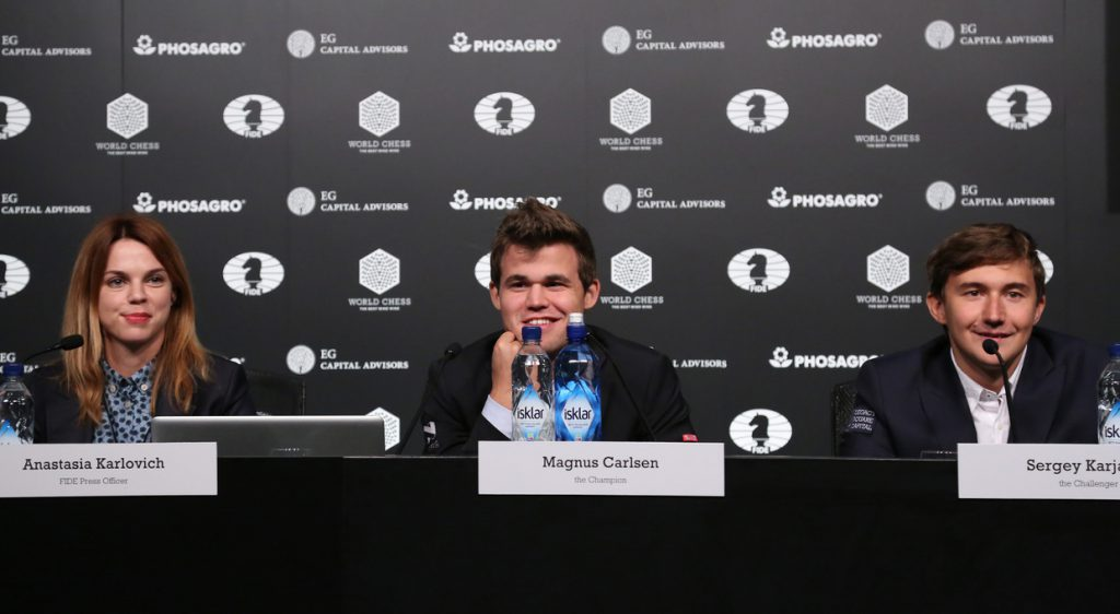 NEW YORK, NY - NOVEMBER 11: (L-R) FIDE Press Officer Anastasia Karlovich, Reigning Chess Champion Magnus Carlsen and Chess grandmaster Sergey Karjakin speak at a press conference after a game during 2016 World Chess Championship at Fulton Market Building on November 11, 2016 in New York City. (Photo by Rob Kim/Getty Images for Agon Limited )